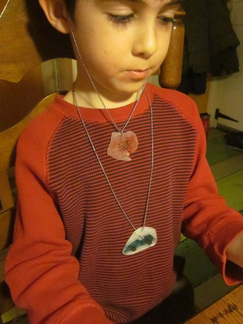Ezra's 'pepperoni' and car necklaces