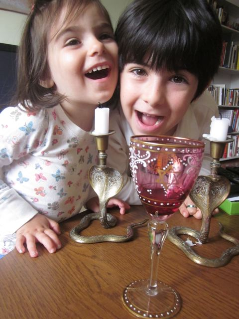 hamming it up for the camera with their favorite cobra candle holders